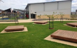 Surrounding the oval are feature garden beds, bench seating, multipurpose timber platforms and shade shelters.